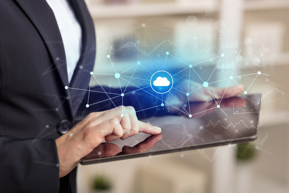Business woman using tablet with financial, cloud connectivity concept-1